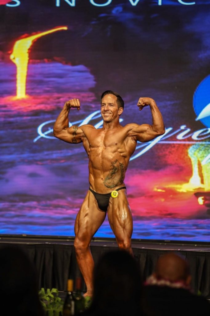 JP on stage in the novice bodybuilding division