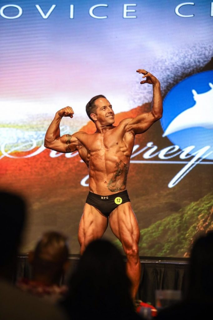 JP on-stage at in Classic Physique Division at 2019 Stingrey Classic